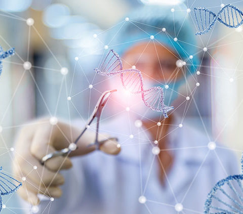 Researcher working with DNA on blurred background.