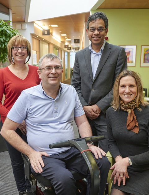 First trial participant Alan Gray with his wife Beverley alongside, Director of the MND-SMART Clinical Trial, Professor Siddharthan Chandran and MND Nurse Consultant, Judy Newton.